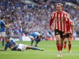 Sunderland's Aiden McGeady (right) celebrates scoring his side's second goal of the game during the Checkatrade Trophy Final at Wembley Stadium, London.
