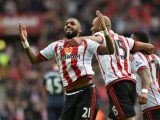 Sunderland's Yann M'Vila (left) celebrates their second goal of the game scored by team-mate Billy Jones (not in picture) during the Barclays Premier League match at the Stadium of Light, Sunderland.